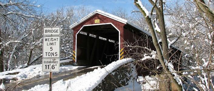 Covered bridge in snow