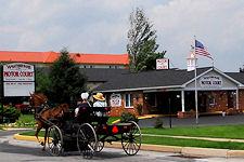 Amish buggy past Weathervane Motor Court