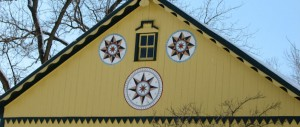 Hex signs on yellow barn