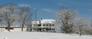 Amish house with windmill in snow