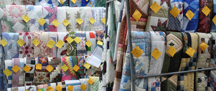 Quilts ready to be auctioned at the Gordonville Mud Sale