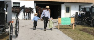 Amish father and children