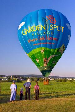 Amish family watching hot air balloon