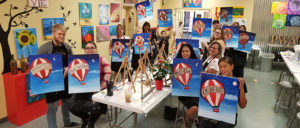 Host your holiday party at Painting with a Twist